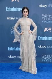 Lily Collins looked heavenly at the Critics' Choice Awards in a silver Elie Saab Couture lace gown with a high neckline and bell sleeves.