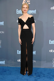 Nicole Kidman was edgy-sexy at the Critics' Choice Awards in a black Brandon Maxwell gown, featuring an angular off-the-shoulder neckline, a midriff cutout, and a high front slit.