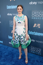 Gillian Jacobs added extra shimmer with a silver crystal clutch.