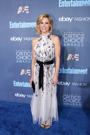 Julie Bowen went the sweet route in a white Monique Lhuillier halter gown with black floral embroidery at the Critics' Choice Awards.