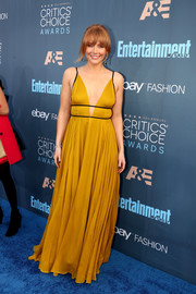 Bryce Dallas Howard looked like a modern-day goddess in this plunging mustard empire gown by Topshop at the Critics' Choice Awards.
