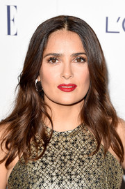Salma Hayek made an appearance at the Elle Women in Hollywood Awards wearing her hair in center-parted, feathered waves.