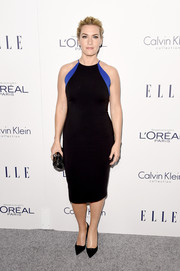 Sporting her signature minimalist-chic style, Kate Winslet attended the Elle Women in Hollywood Awards wearing a custom Badgley Mischka frock styled with simple black pumps.