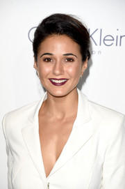 For her beauty look, Emmanuelle Chriqui went a little vampy with her purple lip.
