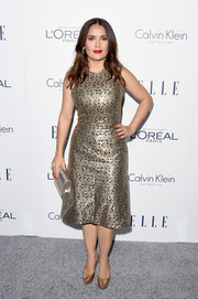 Salma Hayek complemented her dress with classic gold platform peep-toes.