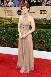 Kate Mara displayed plenty of cleavage (both front and side) in this nude lace gown by Valentino at the SAG Awards.