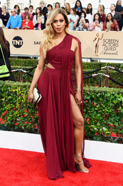 Laverne Cox looked sassy at the SAG Awards in a red Prabal Gurung one-shoulder gown with a waist cutout and a thigh-flaunting slit.