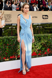 Brie Larson paired her dress with gray satin platform peep-toes by Roger Vivier.