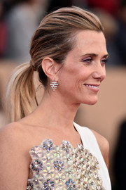 Kristen Wiig rocked a teased ponytail at the SAG Awards.
