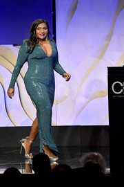 Mindy Kaling shimmered onstage in a micro-beaded teal gown with a plunging neckline and a form-fitting silhouette at the 2020 Costume Designers Guild Awards.