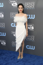Angelina Jolie dolled up in a strapless white Ralph & Russo dress with a feathered neckline and an asymmetrical hem for the 2018 Critics' Choice Awards.