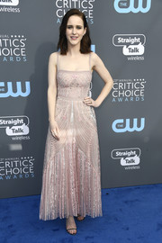 Rachel Brosnahan polished off her look with a pair of metallic slim-strap sandals by Nicholas Kirkwood.