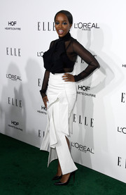 Aja Naomi King completed her ultra-modern ensemble with a white carwash-hem skirt, also by Toni Maticevski.
