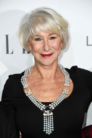 Helen Mirren dolled up her black dress with a statement pearl necklace.