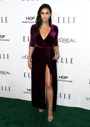 Shay Mitchell attended the Elle Women in Hollywood Awards wearing an aubergine velvet wrap dress by Attico that showcased both cleavage and legs!