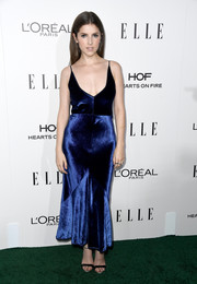 Anna Kendrick styled her dress with black and-silver ankle-strap sandals by Giuseppe Zanotti.
