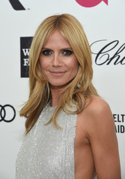 Heidi Klum attended Elton John's Oscar-viewing party wearing her hair in face-framing center-parted layers.