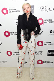 Miley Cyrus rocked a bold-shouldered black cropped jacket by Schiaparelli Couture during Elton John's Oscar-viewing party.