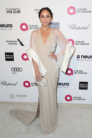 Cara Santana channeled her inner diva in an ultra-sophisticated nude Pamella Roland gown with dramatic sheer sleeves and a long train during Elton John's Oscar-viewing party.