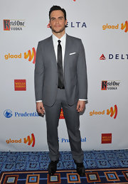 Cheyenne Jackson paired an elegant gray suit with a sleek black tie for a stylish finish.