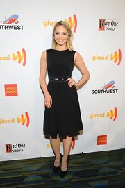 Dianna Agron attended the GLAAD Media Awards in this simple pleated black dress with bow detail.