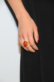 Dianna Agron enhanced her simple look at the GLAAD Awards with an oversized orange ring with a gold band.