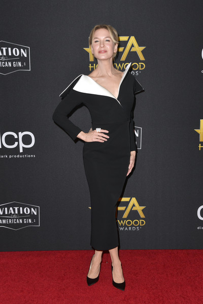 Renee Zellweger cut a slim silhouette in this form-fitting black dress with a contrast collar at the 2019 Hollywood Film Awards.
