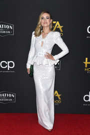 Olivia Wilde looked girly and glam in a sequin-studded white peplum gown by Michael Kors at the 2019 Hollywood Film Awards.