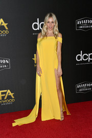 Sienna Miller looked vibrant in a flowing yellow off-the-shoulder dress by Cong Tri at the 2019 Hollywood Film Awards.