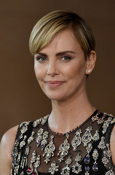 More Pics of Charlize Theron Short Side Part (1 of 6) - Charlize Theron Lookbook - StyleBistro [hair,face,hairstyle,blond,eyebrow,beauty,chin,lip,makeover,dress,the beverly hilton hotel,beverly hills,california,annual hollywood film awards - arrivals,charlize theron]