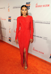 Naya Rivera's gold Tamara Mellon sandals worked beautifully with her red gown.