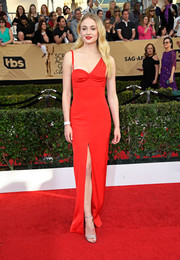 Sophie Turner chose a form-fitting red Louis Vuitton gown with an asymmetrical neckline and a high front slit for her SAG Awards look.