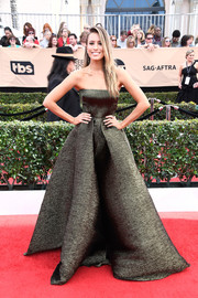 Renee Bargh channeled her inner princess in this Alex Perry strapless ball gown, in a muted olive-green hue, during the SAG Awards.