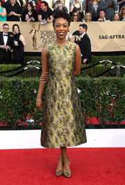 Samira Wiley complemented her frock with a pair of gold ankle-strap heels.