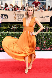 Keltie Knight made a sassy choice with this orange Givenchy gown, featuring a plunging neckline and triangular cutouts along the hips, for her SAG Awards look.