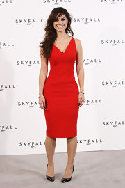 Berenice Marlohe, the new Bond girl, showed off her fierce figure in a red hot cocktail dress at the Bond photocall.