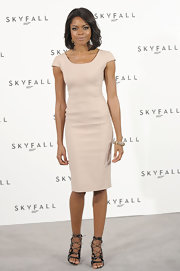 Naomie Harris looked sophisticated in a sleek nude sheath dress for the Bond photocall.