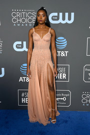 Kiki Layne teamed her dress with silver ankle-strap sandals by Casadei.