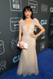 Constance Wu looked enchanting in a beaded blush gown with a plunging neckline and bowed shoulders at the 2019 Critics' Choice Awards.