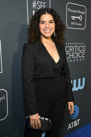 America Ferrera attended the 2019 Critics' Choice Awards carrying an elegant black satin clutch by Tyler Ellis.