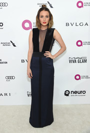 Camilla Luddington attended the Elton John AIDS Foundation Oscar viewing party wearing a two-tone column dress with a cleavage-revealing panel.