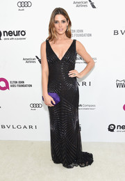 Ashley Greene injected some color with a geometric purple satin clutch by Atelier Swarovski.