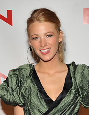 Blake Lively paired her metallic green dress with simple large hoop earrings.