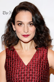Jenny Slate matched her lipstick to her red outfit.