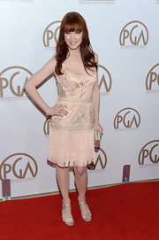 Felicia Day had a flapper vibe to her red carpet look in this peach embroidered dress with a fringe skirt. Silver heels complemented the intricate stitching of the 'Great Gatsby' design.