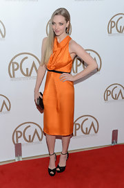Ugh, don't you hate it when wrinkles ruin a look? Don't worry, Amanda, it happens to the best of us. On the bright side, this citrus orange dress added a fun pop of color to the PGA red carpet.