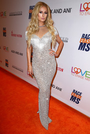 Paris Hilton looked every bit the glamorous bombshell in this figure-hugging silver sequin gown by Yousef Al-Jasmi at the Race to Erase MS Gala.