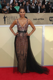 Halle Berry sparkled on the red carpet in a sequined tulle gown by Pamella Roland at the 2018 SAG Awards.