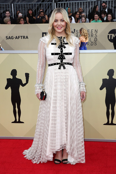 Abbie Cornish went the modest and sweet route in a white Philosophy di Lorenzo Serafini lace gown with black bow detailing at the 2018 SAG Awards.