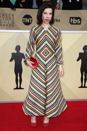 Sally Hawkins sealed off her vibrant look with a red velvet clutch by Tyler Ellis.